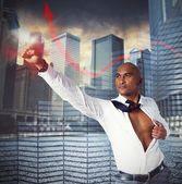 Determined businessman as superhero — Stock Photo