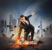 Businessman breaks the asphalt — Stock Photo