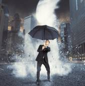 Businessman protected with umbrella — Stock Photo