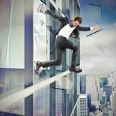 Businessman jumping off a skyscraper — Stock Photo
