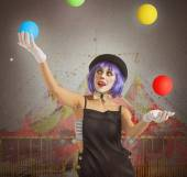 Clown playing with colorful balls — Stock Photo