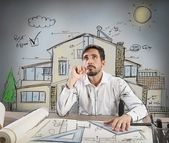 Architect thinks how to design a house — Stock Photo