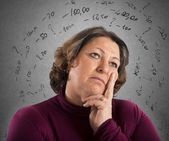Woman thinks like repay its debts — Stock Photo