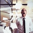 Businessman yelling in office — Stock Photo #72643879
