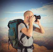 Explorer photographing landscapes — Stock Photo