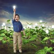 Little boy with light bulb — Stock Photo #73558765
