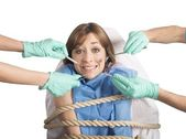 Woman tied to a chair at dentist — Stock Photo
