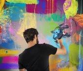 Creative man painting a wall — Stock Photo