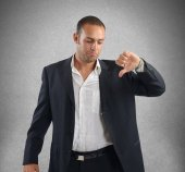 Businessman showing thumb down — Stock Photo