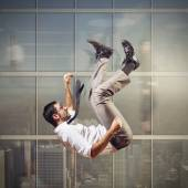 Businessman rushes down — Stock Photo