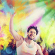 Man plays with colored powders — Stock Photo #75180813
