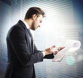 Businessman analyzes work documents — Stock Photo