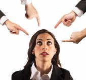 Businesswoman blamed by work colleagues — Stock Photo