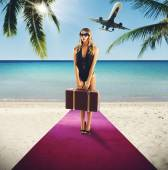 Woman tourist in red carpet on beach — Stock Photo