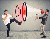 Man fights to a big megaphone — Stock Photo