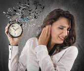 Woman annoyed by alarm clock — Stock Photo