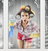Housewife with gloves and spray — Stock Photo