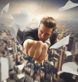 Businessman flying over the city — Stock Photo