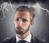 Sad businessman with storm background — Stock Photo