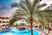 The swimming pool at luxury hotel during sunset, Sharm el Sheikh — Stock Photo