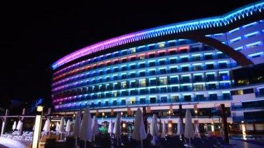 Panning down the building of luxury hotel in night illumination, Antalya, Turkey — Stock Video