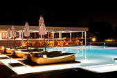 Swimming pool and bar in night illumination at the luxury hotel, — Stock Photo
