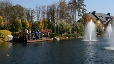 "The panning fountains and ""Khonka"" house in Mezhigirya on October 14, 2014 in Novi Petrivtsi, Ukraine. It is former residence of ex-president Yanukovich, now open to the public — Stock Video"