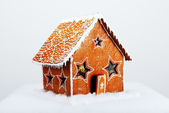 The hand-made eatable gingerbread house and snow decoration — Stock Photo