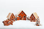 The family near hand-made eatable gingerbread house and New Year — Stock Photo