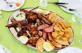 Traditional food in the restaurant on Santorini island, Greece — Stock Photo