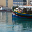 SLIEMA, MALTA - APRIL 22: The panning of traditional Maltese boat for tourists cruises on April 22, 2015 in Sliema, Malta. More then 1,6 mln tourists is expected to visit Malta in year 2015. — Stock Video #73135581