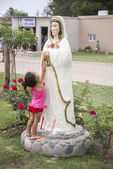 Child touches Mary the Mystical Rose — Stock Photo