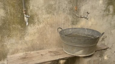 Water Pouring out of a Tap into a Basin — Vídeo de stock