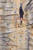 Woman on rock wall — Stock Photo
