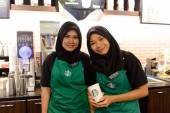 Starbucks staff posing for photo — Stockfoto
