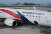 Docked jet Airasia airplane — Stockfoto