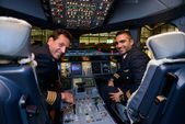 Pilots in Emirates Airbus A380 — Stock Photo