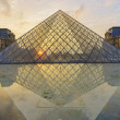 Louvre Palace and Pyramid — Stock Photo #63300545