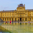 Louvre Palace and  Pyramid — Stock Photo #63300739