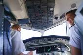 Pilots in aircraft cockpit — Stock Photo