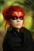 Red hair woman in mask — Zdjęcie stockowe
