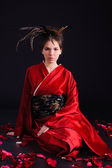 The girl in native costume of japanese geisha — Stock Photo