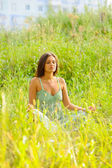 Woman rest in the grass — Stock Photo