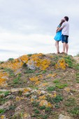 Couple stand on the hill — Stock Photo