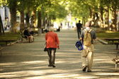 People walking in the park — Stock Photo