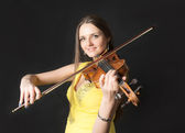Violinist on black background — Stock Photo
