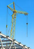 Hoisting crane against the blue sky — Stock Photo