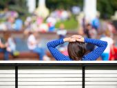 Young woman relaxing on a bench — Stock Photo