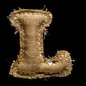 Linen or hemp vintage cloth letter L — Stock Photo