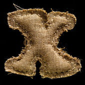 Linen or hemp vintage cloth letter X — Stock Photo